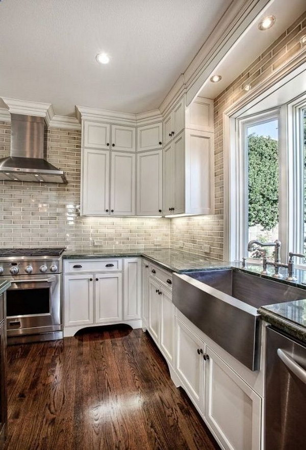Off White Kitchen Cabinets with Brick Backsplash.
