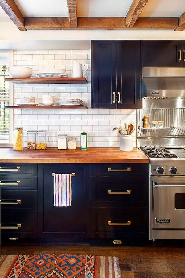 Navy Painted Cabinets with Wood Countertop and Brass Hardware.