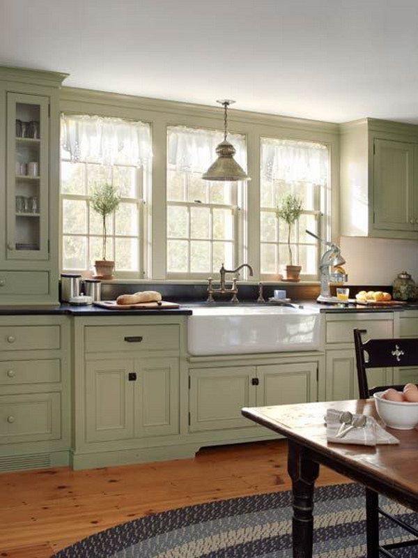 Grey green Cabinets Paired with Apron Sink and Double Hung Windows.