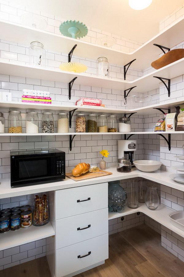 Open Panel Shelves with White Subway Tile Backsplash and Black Appliances.