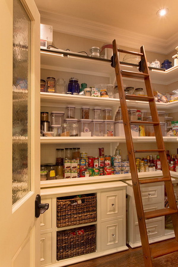 Traditional Kitchen Pantry with a Cool Wooden Ladder for Easy Access to Everything.