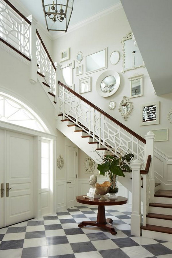 Classic Entryway with a Mirror Galery wall.