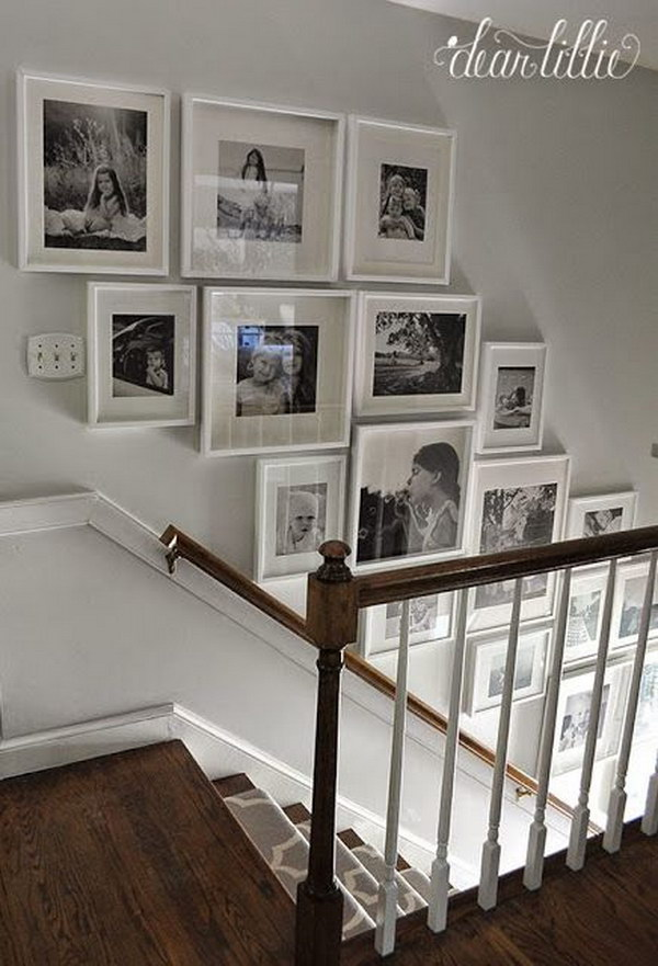 Create a gallery wall filled with all sorts of family photos. It's a great idea being able to look at all the photographs and see so many different memories every time you climbed the stairs.