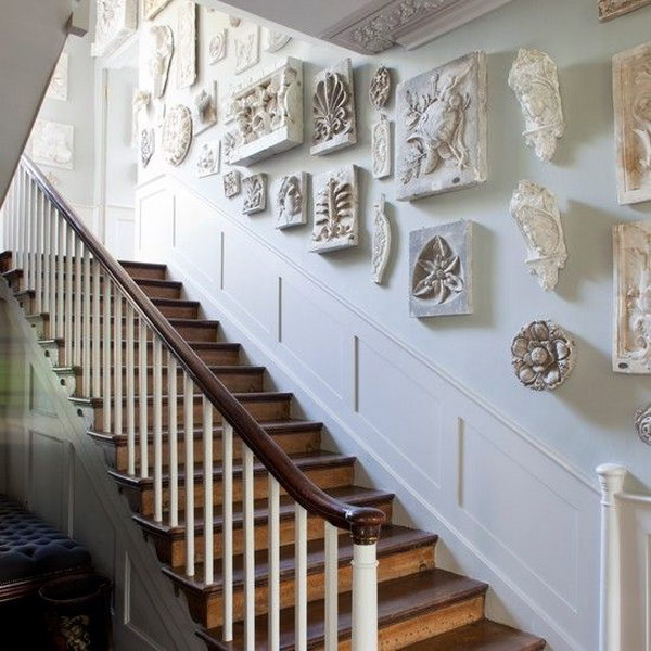 striking sculptures  give this regency inspired hallway timeless appeal.