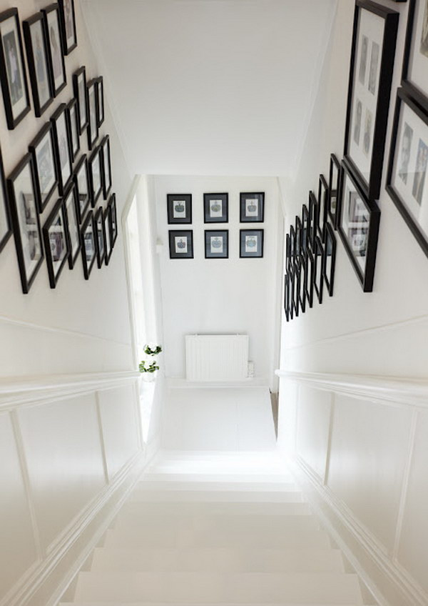 White Staircase With Black Framed Photos.