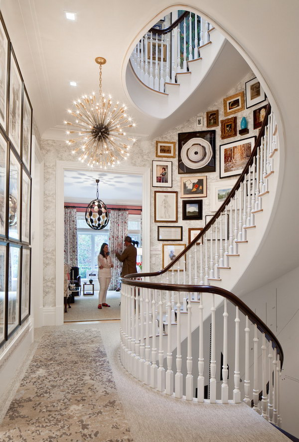 Chic Spiral Staircase With Gallery Wall.