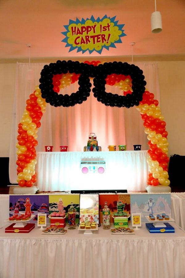 Yo Gabba Gabba Cake and Desert Table under Balloon Arch.