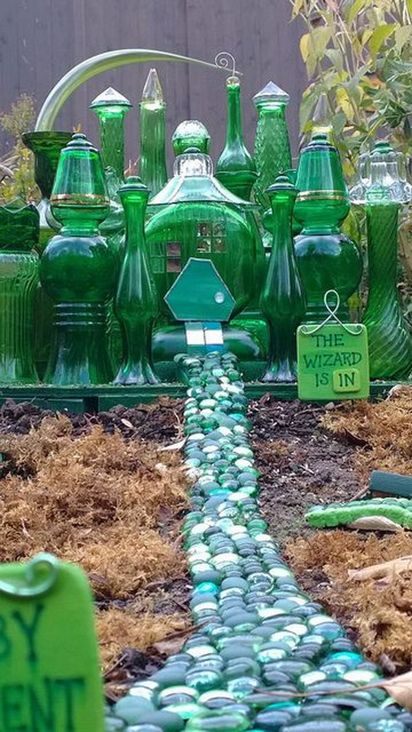 Mini Emerald City Fairy House Made With Green Glassware.