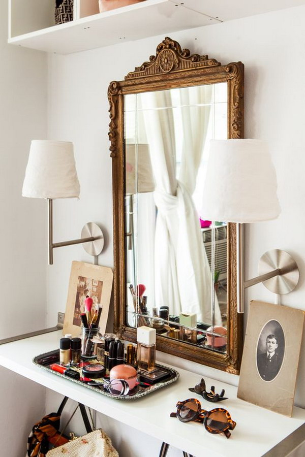 Closet Vanity With A Floating Shelf And Oversized Gold Mirror