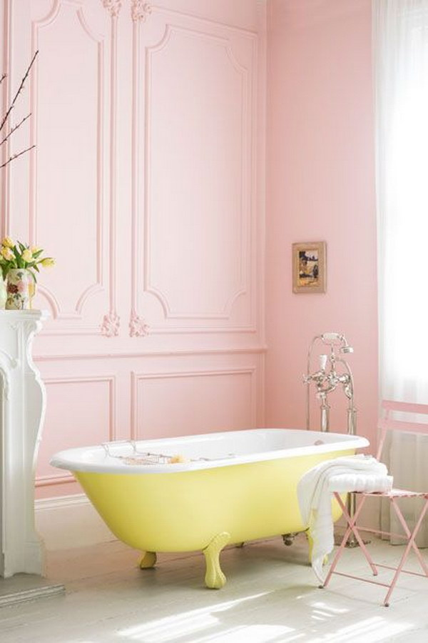 Pink Bathroom With Yellow Roll Top Bath