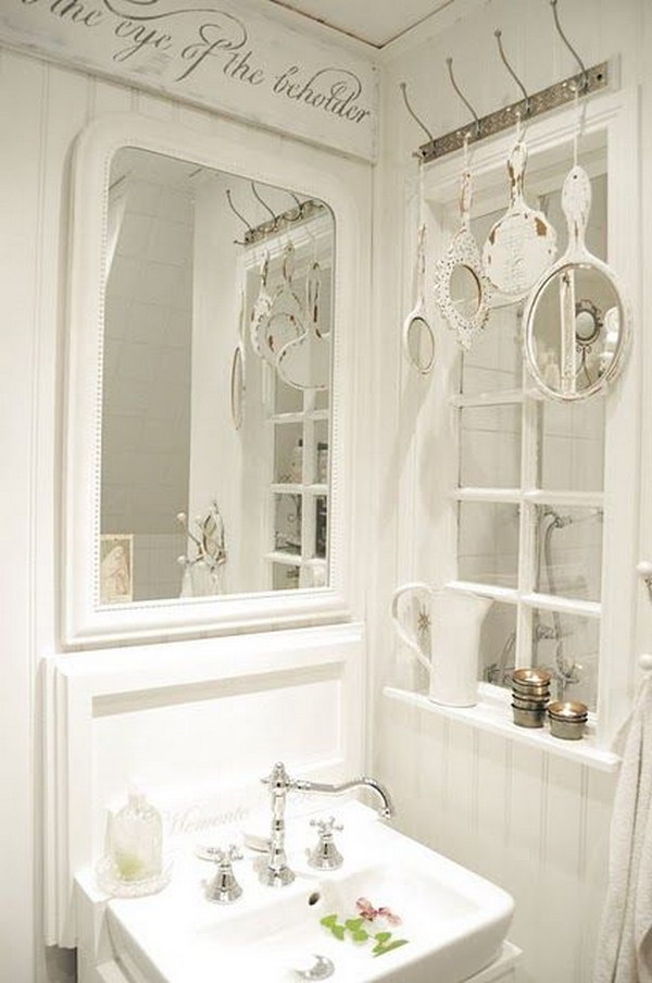 Old Hand Mirrors Displaying Above Bathroom Window