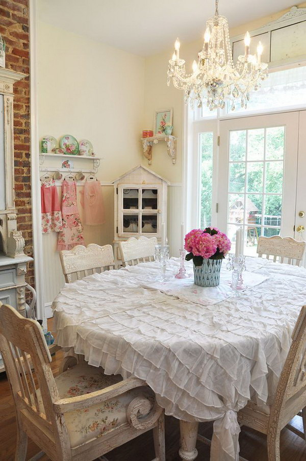 Shabby Chic Dining Room With Ruffled Tablecloth and Crystal Chandelier