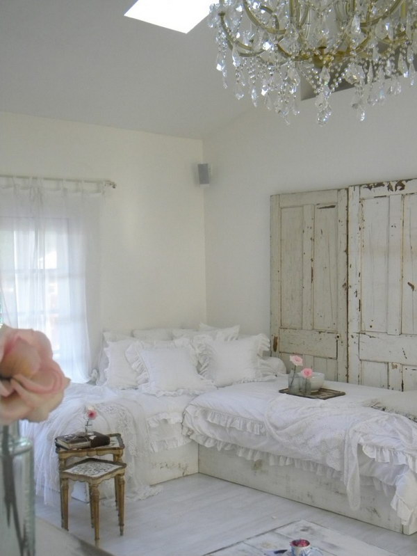 Charming Shabby Chic Living Room With Crystal Chandelier and Vintage Doors