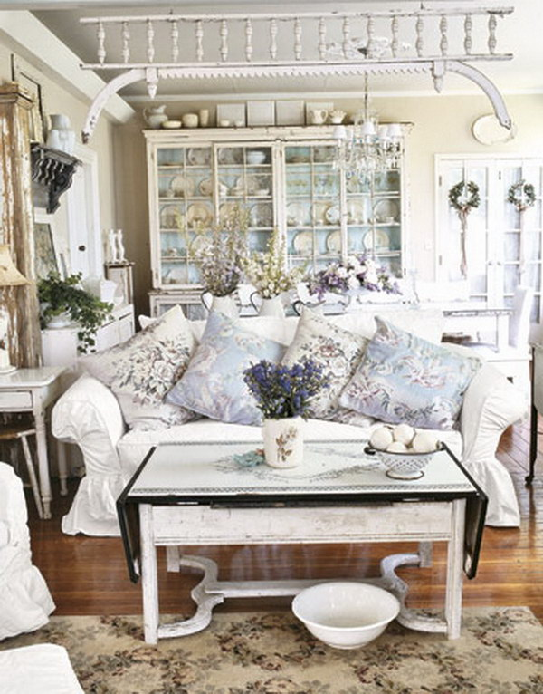 Shabby Chic Living Room Decorated with Antique Finish White, Floral Fabrics Ceramics and Tableware